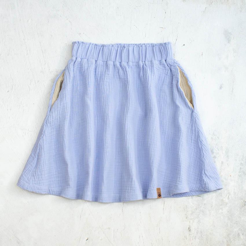 Knielanger Musselinrock für Kinder in pastelllila (flieder) mit sandfarbenen Eingrifftaschen